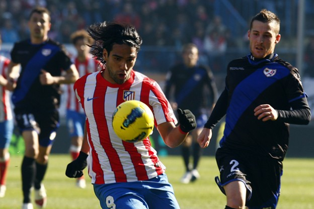 atletico madrid striker radamel falcao takes on rayo defender tito
